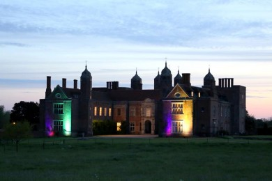Melford Hall lit up at night